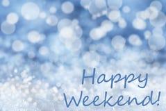 Blauer Bokeh-Weihnachtshintergrund, Schnee, simsen glückliches Wochenende Lizenzfreies Stockfoto