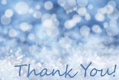 Blauer Bokeh-Weihnachtshintergrund, Schnee, Text danken Ihnen Stockfoto
