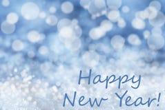 Blauer Bokeh-Weihnachtshintergrund, Schnee, Text-guten Rutsch ins Neue Jahr Lizenzfreie Stockfotografie