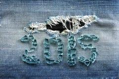 Blauer Denimbaumwollstoff mit Zahl lizenzfreies stockbild