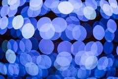 Blauer funkelnder festlicher Hintergrund der Lichter mit Beschaffenheit Abstraktes Weihnachten funkelte das helle defocused bokeh Lizenzfreies Stockbild
