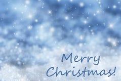 Blauer funkelnder Hintergrund, Schnee, simsen frohe Weihnachten Stockfoto