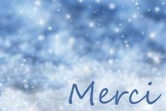 Blauer funkelnder Weihnachtshintergrund, Schnee, Merci-Durchschnitte danken Ihnen Stockfotografie