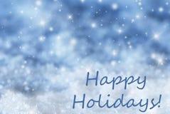 Blauer funkelnder Weihnachtshintergrund, Schnee, simsen frohe Feiertage Stockfoto