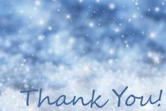 Blauer funkelnder Weihnachtshintergrund, Schnee, Text danken Ihnen Stockfotos