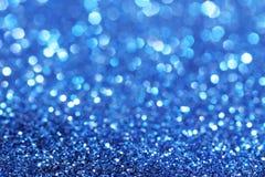 Blauer Funkelnweihnachtszusammenfassungshintergrund Stockfoto