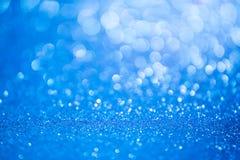 Blauer Funkelnweihnachtszusammenfassungshintergrund lizenzfreie stockbilder