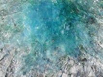 Blauer gebrochener Glashintergrund Stockfoto