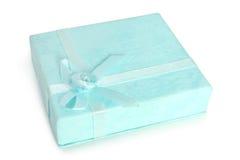 Blauer Geschenkkasten mit Farbband Stockbild
