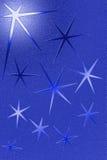Blauer grungy Hintergrund mit fünf gezeigten Sternen Lizenzfreie Stockbilder