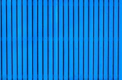 Blauer hölzerner gemalter Zaun Stockbild