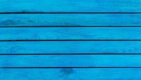 Blauer hölzerner Hintergrund mit Leerstelle Stockbild