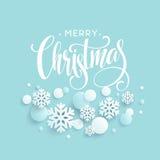 Blauer Hintergrund der frohen Weihnachten mit papercraft Schneeflocke Grußbeschriftungskarte Auch im corel abgehobenen Betrag Stockbild