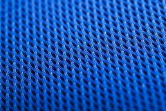 Blauer Hintergrund. Maschengewebebeschaffenheit. Makro Stockfoto