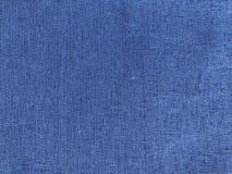 Blauer Hintergrund mit Leinengewebe lizenzfreie stockbilder