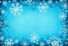 Blauer Hintergrund mit Schneeflocken Stockfoto