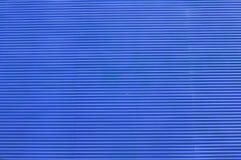 Blauer Hintergrund mit Streifenmuster Lizenzfreie Stockfotografie