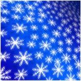 Blauer Hintergrund von weißen Winterschneeflocken für Weihnachten und neu Stockfoto