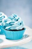 Blauer kleiner Kuchen Stockfotos