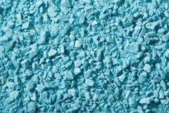 Blauer Lidschatten zerquetscht, kosmetischer Hintergrund lizenzfreies stockfoto