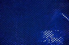 Blauer paillettenbesetzter funkelnder Stoffhintergrund Stockbild