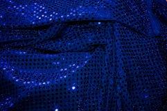 Blauer paillettenbesetzter Gewebehintergrund Lizenzfreie Stockfotos