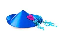 Blauer Partyhut mit einem roten Inneren Stockbild