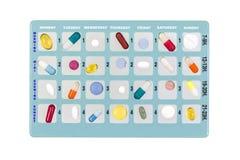 Blauer Pillenkasten für Lagerung von Drogen, mit Aufschriften des Momentes des Wochentags auf Weiß Lizenzfreie Stockfotos