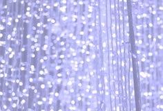 Blauer purpurroter Pastellfunkelnhintergrund, Linse bokeh Effekt Stockfotografie