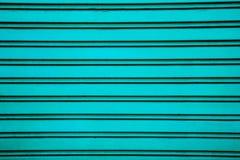 Blauer Stahlrollenfensterladen-Türhintergrund (Garagentor mit hor Lizenzfreie Stockfotografie