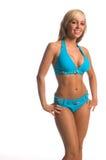 Blauer Stein-Bikini-Blondine Stockfoto