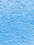 Blauer strukturierter Hintergrund auf der Seite eines Gebäudes Lizenzfreies Stockbild