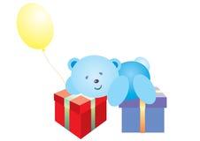 Blauer Taddy-Bär mit Geschenken Stockfotos