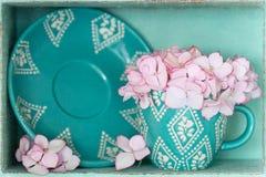 Blauer Tee-Becher Stockbild