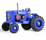 Blauer Toy Tractor auf Weiß Lizenzfreie Stockfotografie