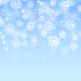 Blauer Weihnachtshintergrund mit Schneeflockenvektor Stockbilder