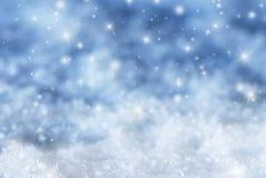 Blauer Weihnachtshintergrund mit Sternen Stockfoto