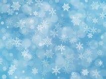 Blauer Winter boke Hintergrund mit Schneeflocken Stockbild