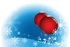 Blauer Winter mit roten Kugeln Lizenzfreie Stockfotografie