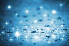 Blauer Winterhintergrund mit Sternen lizenzfreies stockbild