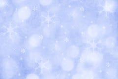 Blauer Winterschneeflockenhintergrund für Weihnachten lizenzfreie stockfotografie