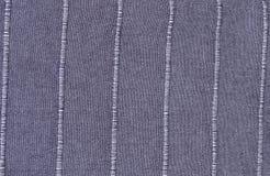 Blaues Baumwollgewebe mit Streifen-Muster-Hintergrund Lizenzfreie Stockfotos