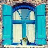 Blaues Fenster und Fensterladen, Kreta, Griechenland Lizenzfreie Stockfotografie