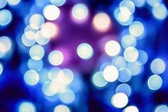 Blaues festliches Weihnachtseleganter abstrakter Hintergrund mit bokeh beleuchtet lizenzfreie stockbilder