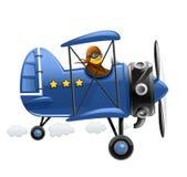 Blaues Flugzeug mit Piloten Stockfotos