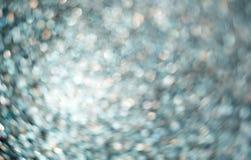 Blaues Funkeln glänzend, bokeh Weihnachtshintergrund Stockfoto