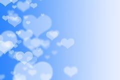 Blaues Herzen bokeh als Hintergrund Stockbild