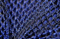 Blaues Ineinander greifen Stockbild