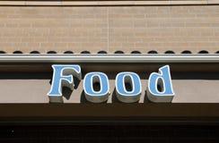 Blaues Nahrungsmittelzeichen Stockfotografie
