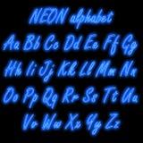 Blaues Neonalphabet Stockfotografie